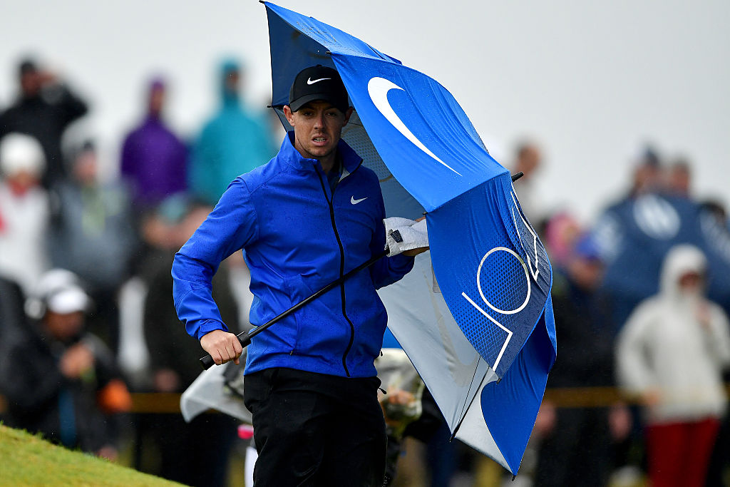 30mph gusts off the Firth of Clyde made rain fly, and umbrellas be held, horizontally Friday at the British Open.