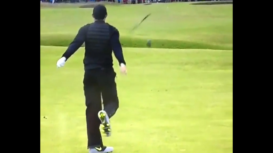 Rory McIlroy slams his club after a poor shot during the third round of the British Open.