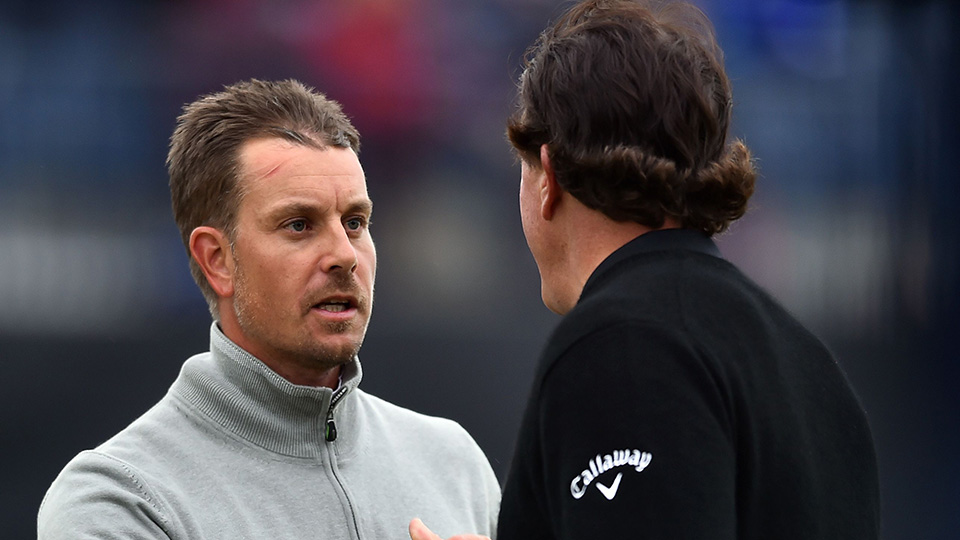 Phil Mickelson and Henrik Stenson shakes hands on the 18th green after their third rounds on day three of the 2016 Open Championship at Royal Troon.