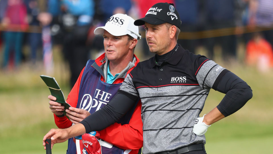 Henrik Stenson and caddie Gareth Lord check out the green on the 16th hole during the final round of the British Open on Sunday.