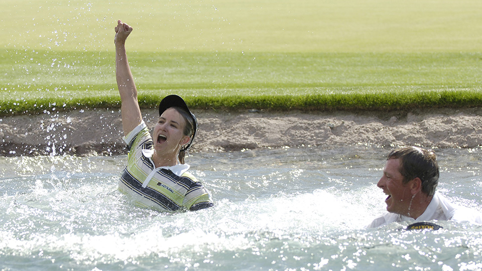 Karrie Webb, winner of the Kraft Nabisco Championship, takes the traditional dip into Poppy's Pond at The Mission Hills Country Club in Rancho Mirage, California on Sunday, April 2, 2006.