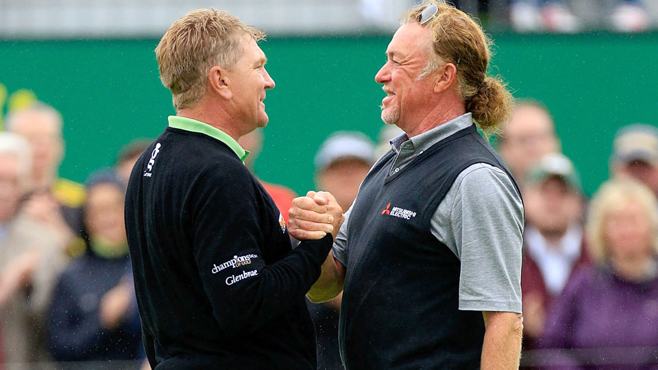 Paul Broadhurst shakes hands with Miguel Angel Jimenez on the 18th green after winning the Senior Open Championship at Carnoustie on Sunday.