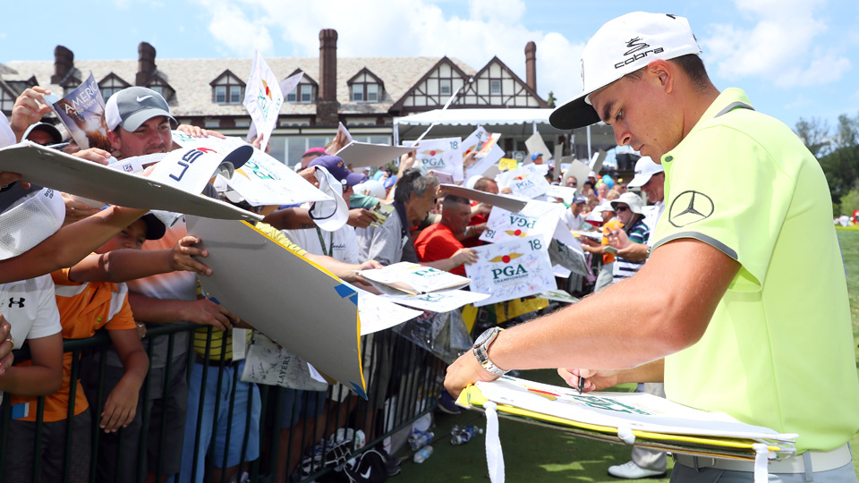 How many items purchased in the merchandise tent does Rickie Fowler (and other pros) sign this week? A lot.