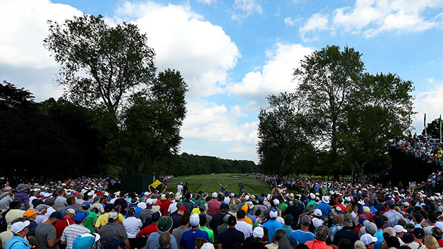 A gallery of fans watch Rory McIlroy play his shot from the seventh tee during the second round of the 2016 PGA Championship at Baltusrol Golf Club