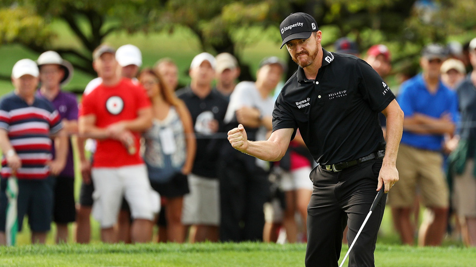 Jimmy Walker celebrates after sinking a birdie putt on the 11th hole during the final round of the PGA Championship on Sunday at Baltusrol Golf Club. Walker picked up his first major title.