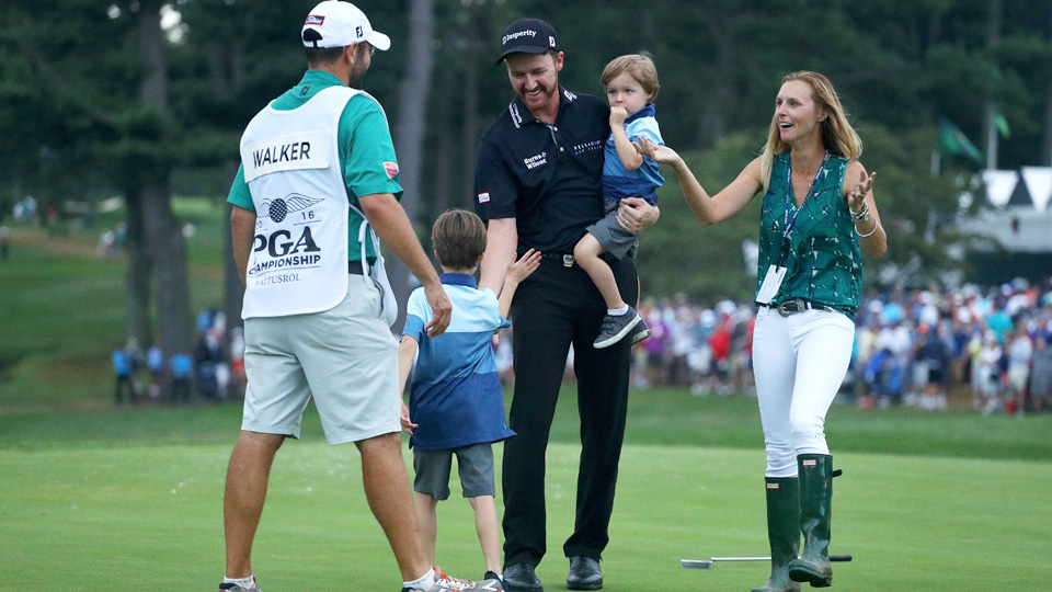 Jimmy Walker celebrates with his family and caddie after sinking the final putt.