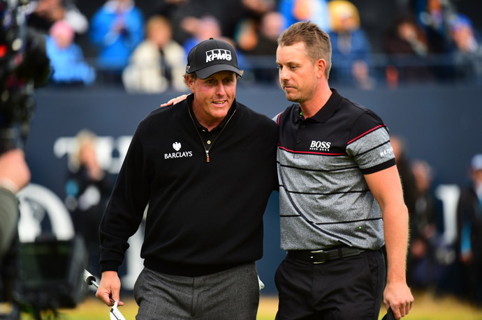 Henrik Stenson and Phil Mickelson walk of the 18th green after an epic battle at Royal Troon.