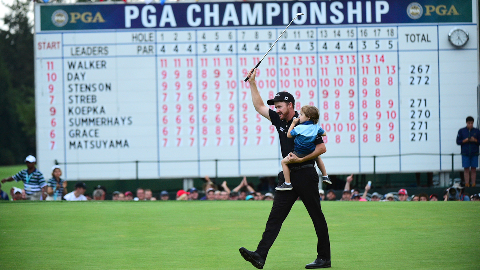 With son Beckett in hand, Walker walked off with his first major championship at the PGA.