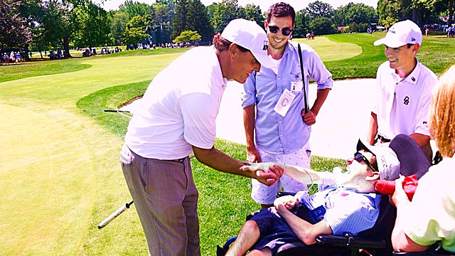 David shakes hands with Phil Mickelson, who he met at the 2005 PGA.
