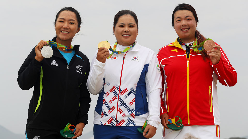 Lydio Ko (left), Inbee Park (center) and Shanshan Feng pose with their Olympic medals.