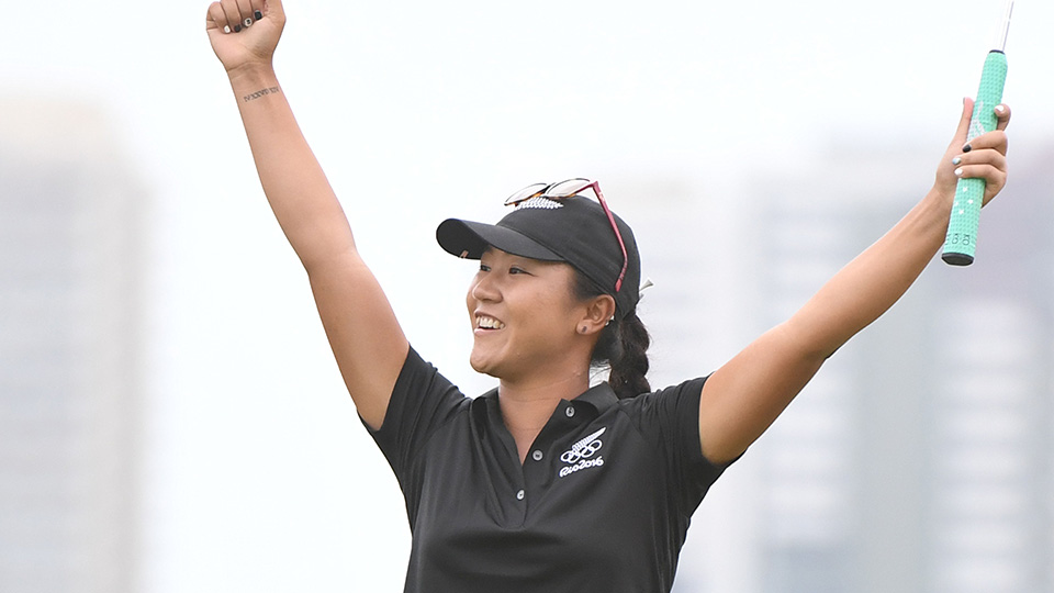 Lydia Ko celebrates as she makes a birdie putt on 18 to claim the women's golf silver medal at the 2016 Rio Olympics.