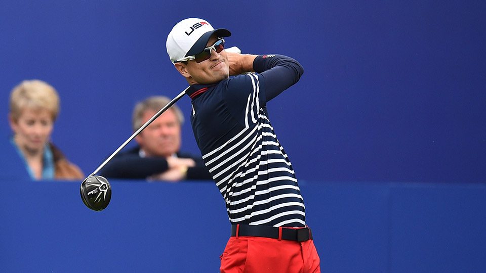 Zach Johnson tees off the first hole during the singles matches at the 2014 Ryder Cup at Gleneagles in Scotland.