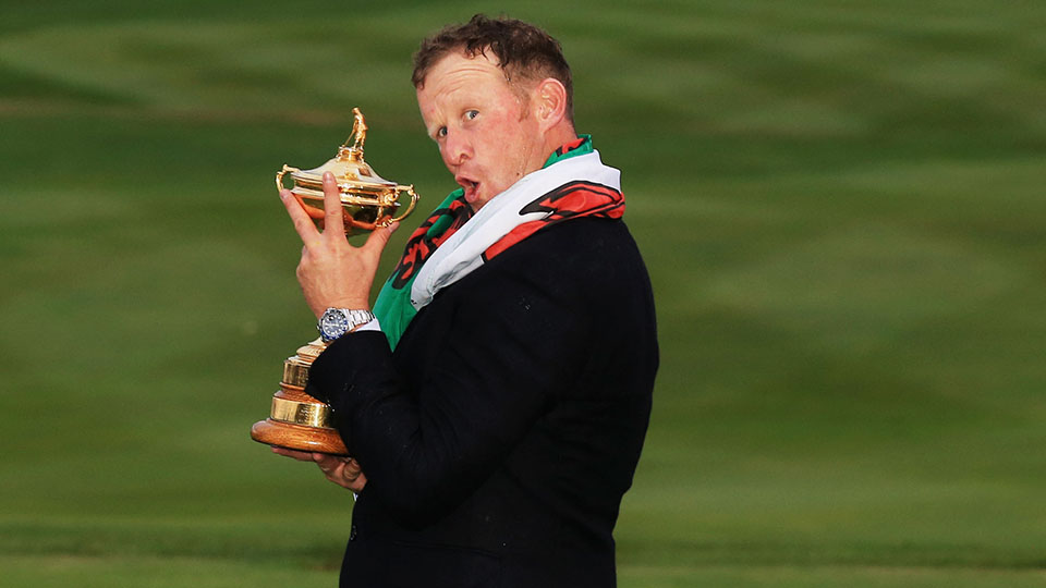 Jamie Donaldson, who's stellar approach on the 15th hole secured the victory for Team Europe, poses with the Ryder Cup.