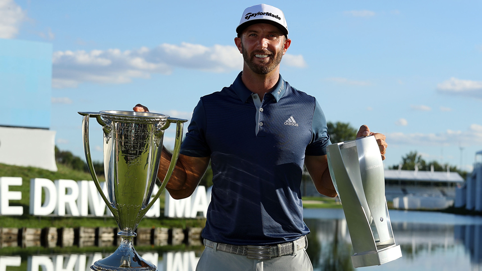 Dustin Johnson hoisted multiple trophies Sunday after winning the BMW Championship at Crooked Stick Golf Club.