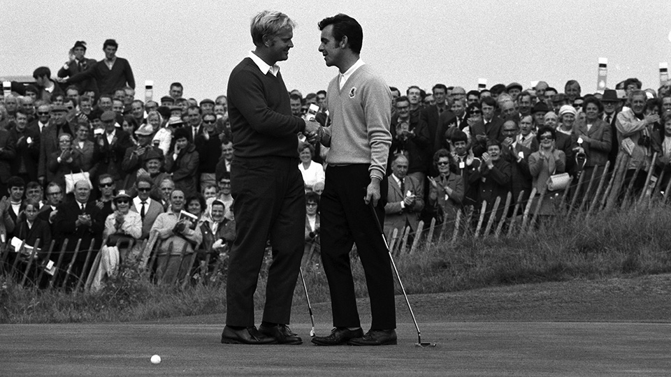 Jack Nicklaus congratulates Tony Jacklin after conceding a two-foot putt on the final hole of the 1969 Ryder Cup.