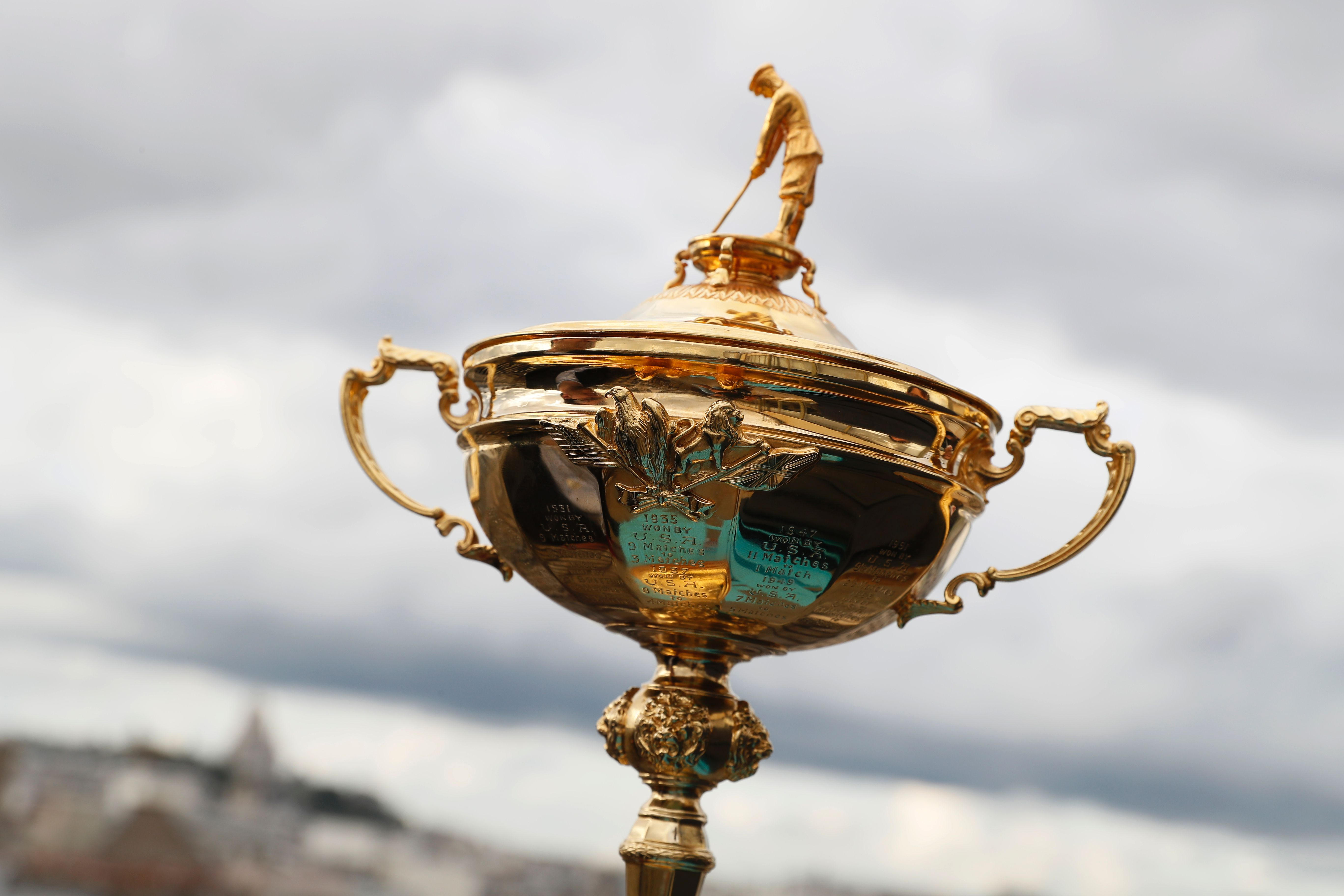 Who is that man on top of the Ryder Cup? It's not Samuel Ryder.