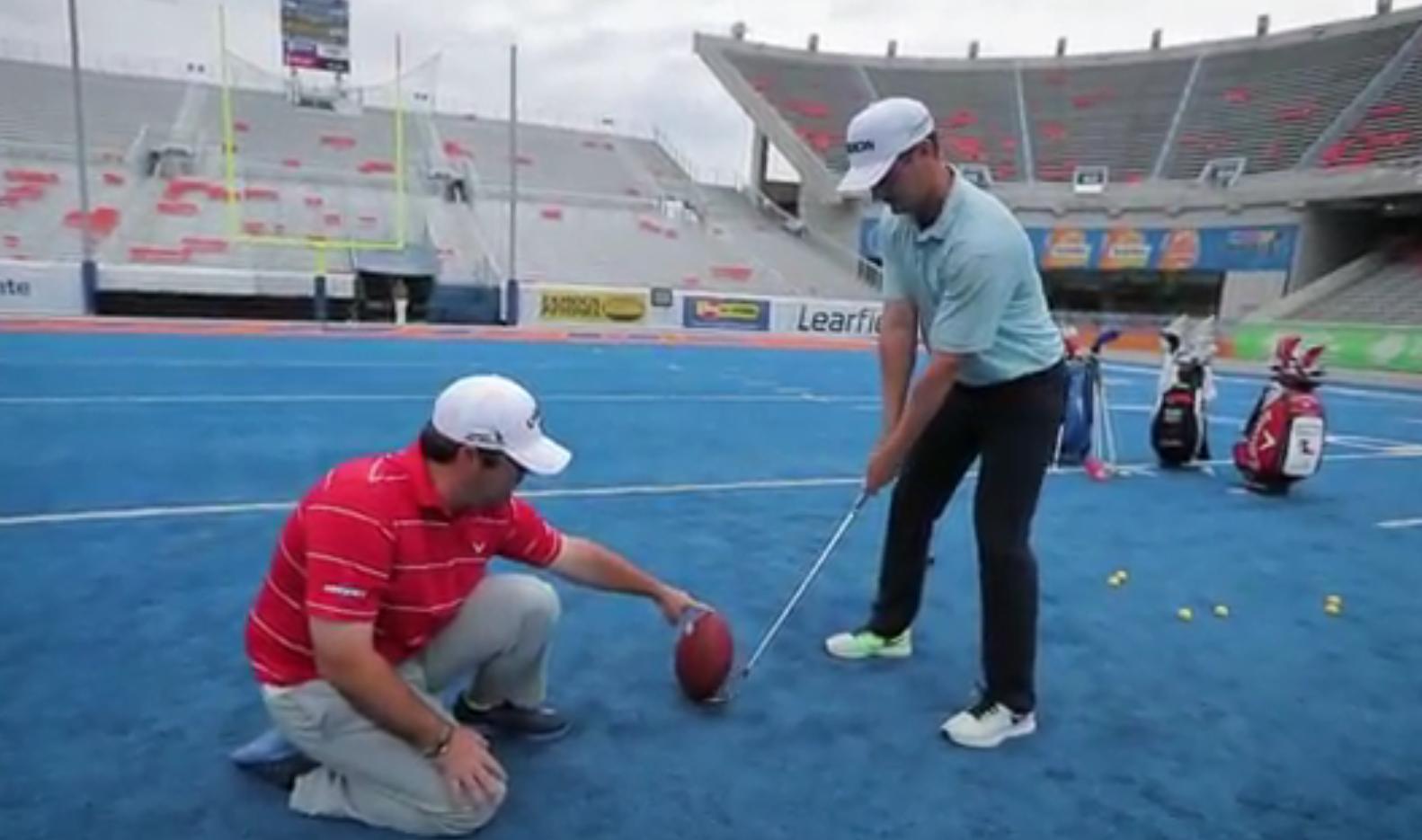Rick Lamb attempts a 33-yard field goal with a golf club.
