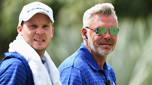 Darren Clarke, captain of Team Europe, looks on with Danny Willett during the final day's singles matches at the EurAsia Cup presented by DRB-HICOM at Glenmarie G&CC on January 17, 2016 in Kuala Lumpur, Malaysia.
