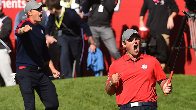 Team USA Patrick Reed (R) reacts with teammate Jordan Spieth after winning their match against Team Europe Justin Rose and Henrik Stenson on the 16th green during the Morning Foursome matches at the 41st Ryder Cup at Hazeltine National Golf Course.