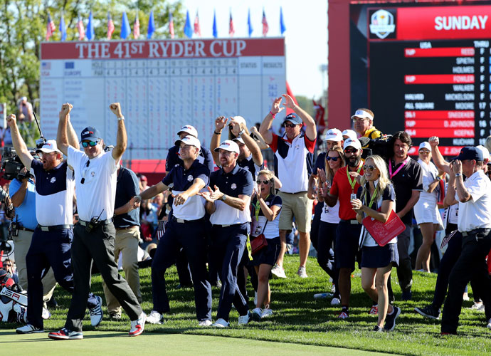 The U.S. team spilled on the 18th green after Ryan Moore secured the point to clinch the Ryder Cup.