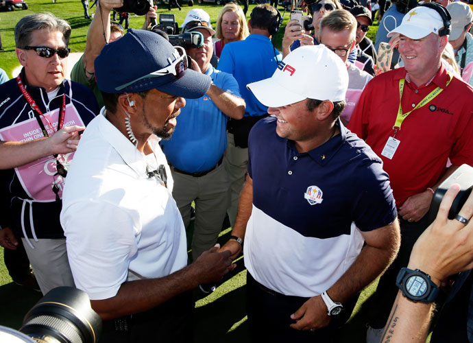 Vice captain Tiger Woods congratulates Patrick Reed.