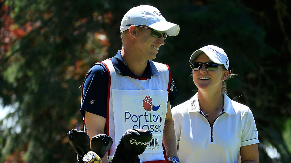 Ernst's brother Drew has been her caddie for three years.