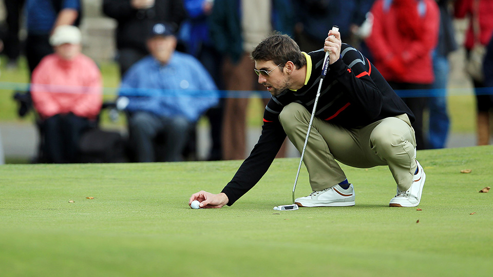 U.S. Olympic swimmer Michael Phelps prepares to putt during day one of the 2012 Alfred Dunhill Links Championship.