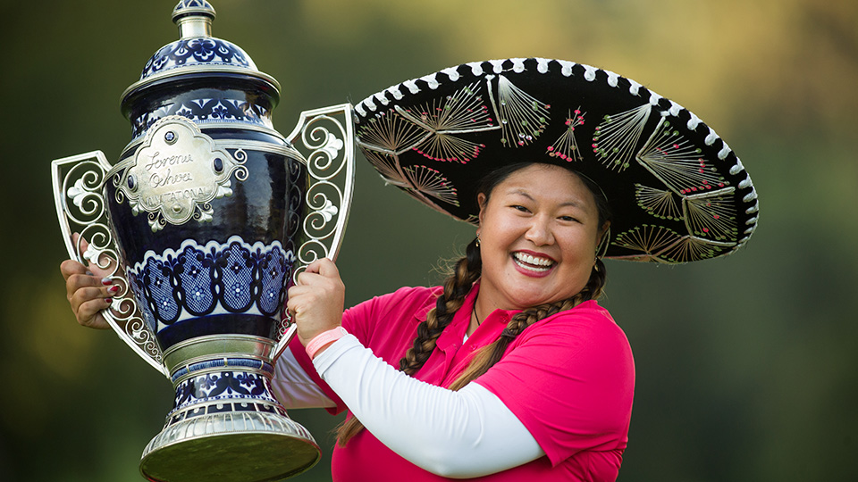 Christina Kim celebrates her victory at the 2014 Lorena Ochoa Invitational, her first in nine years.