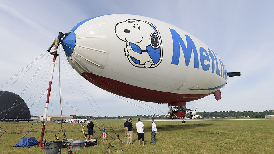 The ground crew prepares the MetLife Snoopy Two Blimp prior to the final round of the 2016 WGC-Bridgestone Invitational at Firestone Country Club.