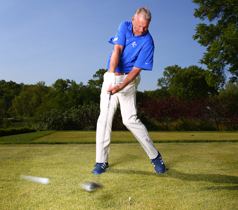 As your weight shifts forward, keep your hands back, as in a check swing. Then let 'em rip!