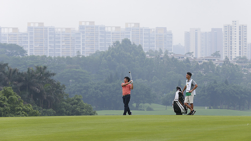 Dou Zecheng (or Marty) of China plays a shot during the third round of the Shenzhen International at Genzon Golf Club on April 23, 2016 in Shenzhen, China.