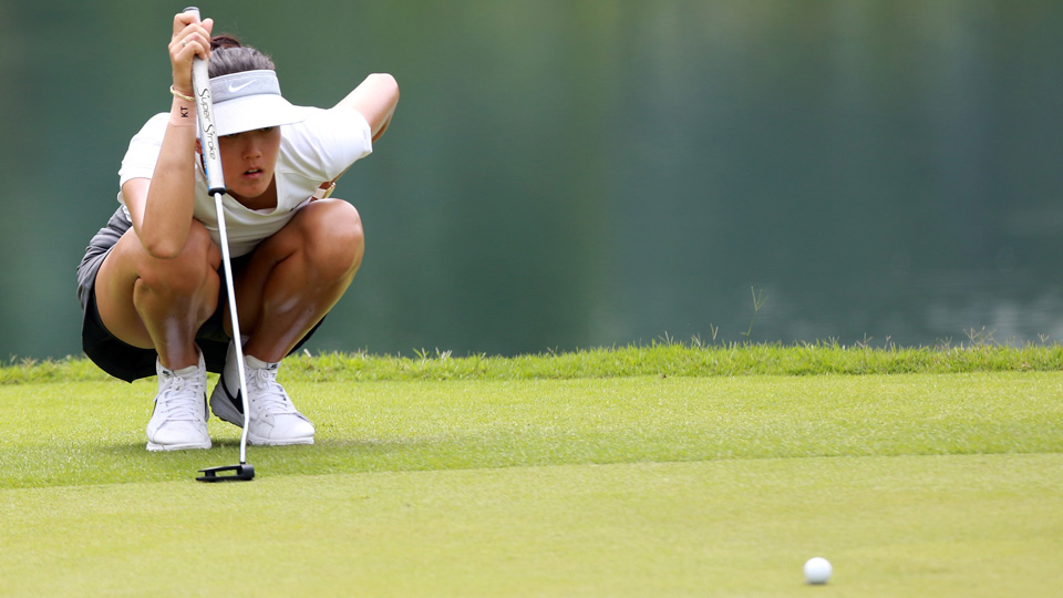 Michelle Wie lines up a putt on the 6th hole during Round 1 of the Sime Darby LPGA at TPC Kuala Lumpur on Thursday.