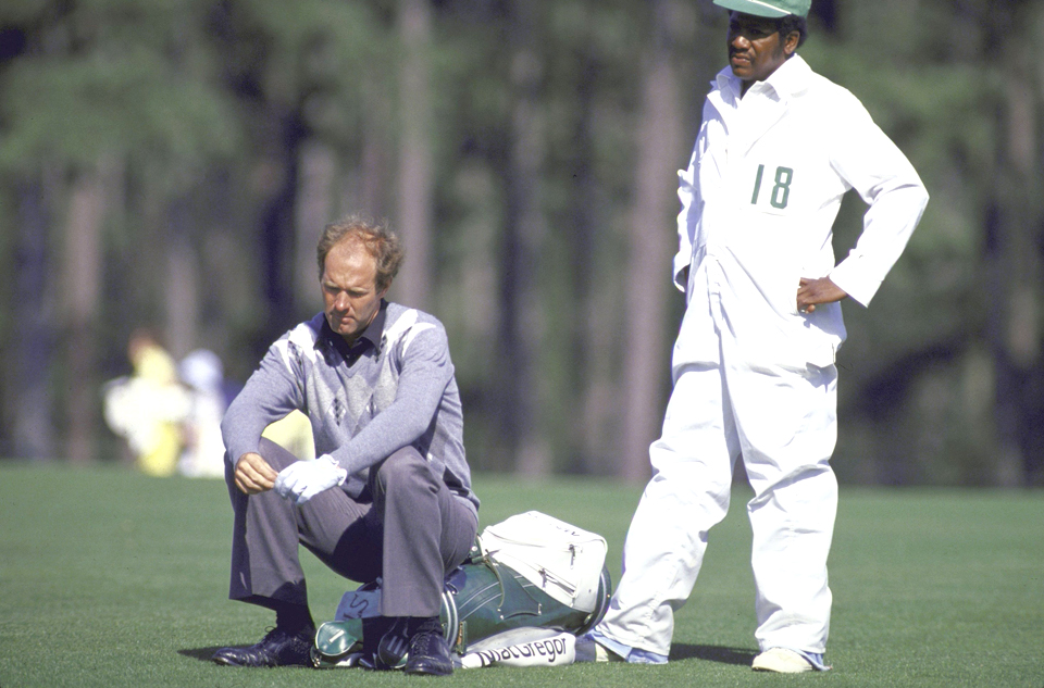 Tom Weiskopf sits on his bag after making a 13 on the par-3 12th during the 1980 Masters.