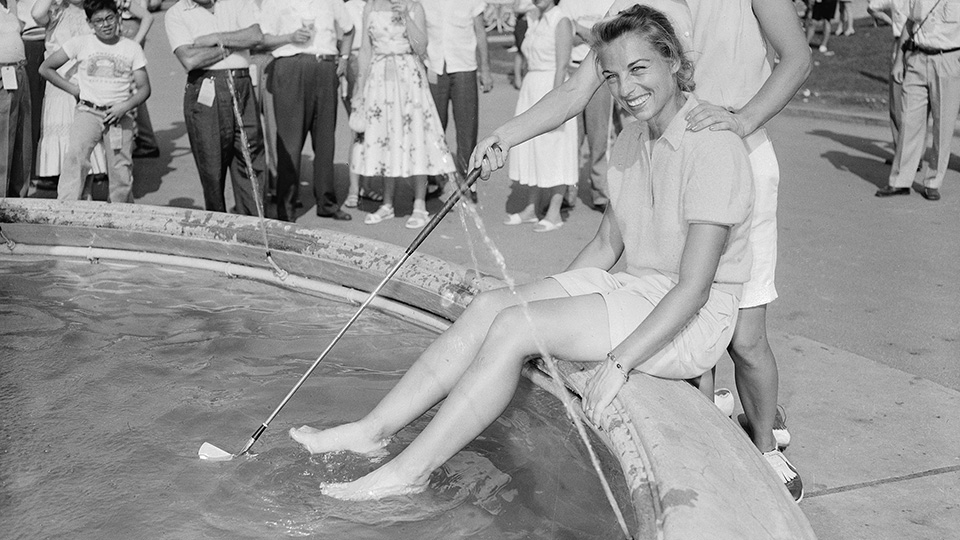 Marlene Bauer Hagge cools her feet in a fountain after winning the $6,000 first prize for women's professional division of the 1956 Tam O'Shanter World Championships.