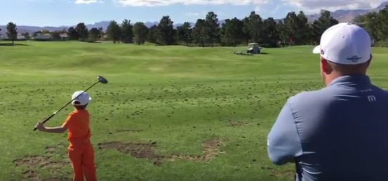 Five-year-old Tommy Morrissey impresses Colt Knost on the golf course at the Shriners Open.