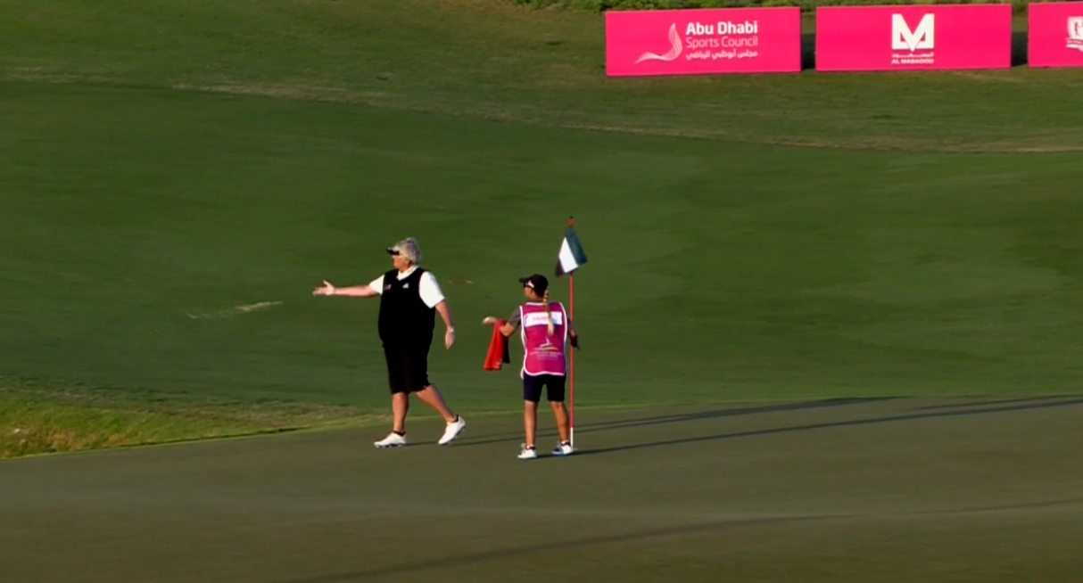 Laura Davies tosses her putter into a lake after making a double-bogey on the 18th hole.
