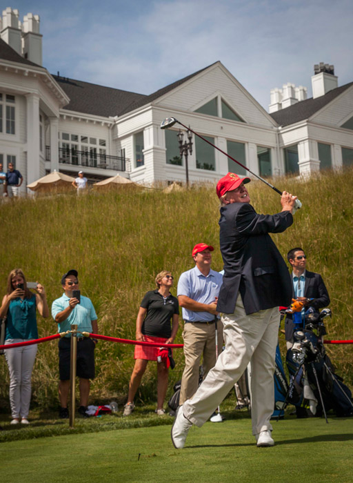 Donald Trump joins in the celebration of the opening of his championship golf course, in Sterling, VA. June 23, 2015.