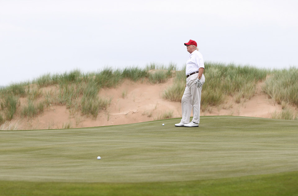 Donald Trump plays a round of golf after the opening of The Trump International Golf Links Course on July 10, 2012 in Balmedie, Scotland.