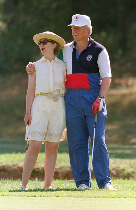 President Bill Clinton (R) and First Lady Hillary Clinton give each other a hug while playing golf at the Mink Meadows Golf Club on Martha's Vineyard August 27, 1993 in Massachusetts. The First Family was vacationing on the island.