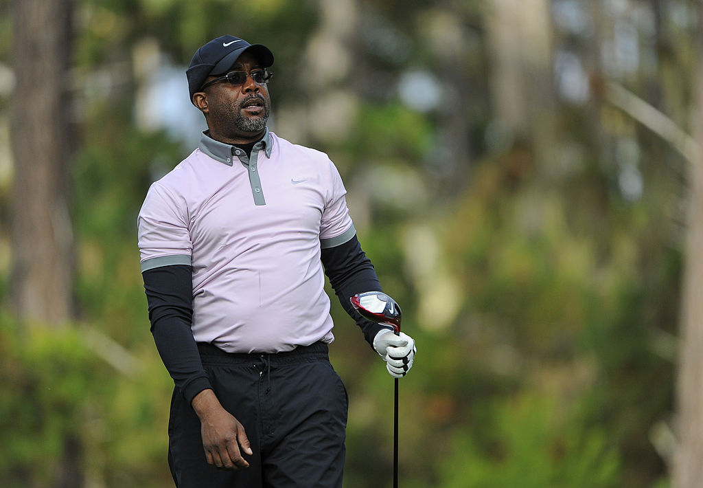 Recording artist Darius Rucker plays from the ninth tee during the first round of the AT&T Pebble Beach National Pro-Am at Spyglass Hill Golf Course on February 6, 2014.