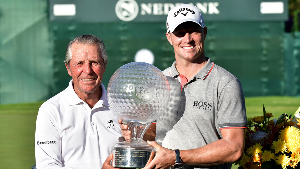 Gary Player presents a trophy to Alex Noren following his victory at the 2016 Nedbank Challenge.