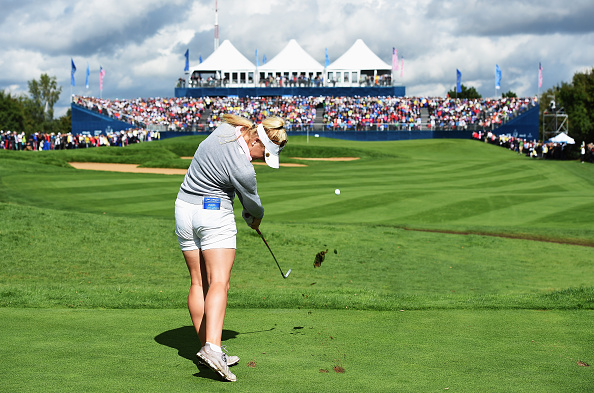 Charley Hull of team Europe plays a shot during the morning foursomes matches at The Solheim Cup at St Leon-Rot Golf Club.