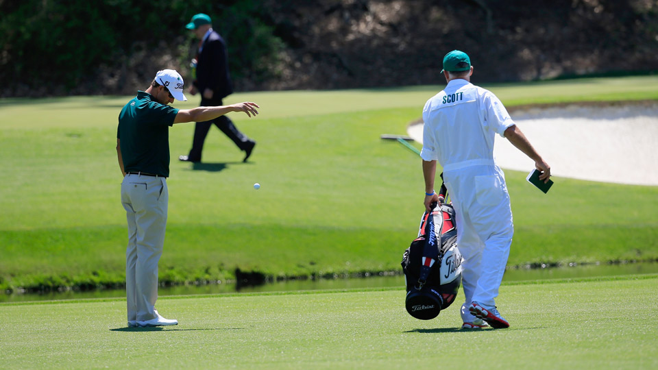 Adam Scott takes a drop during the 2014 Masters.