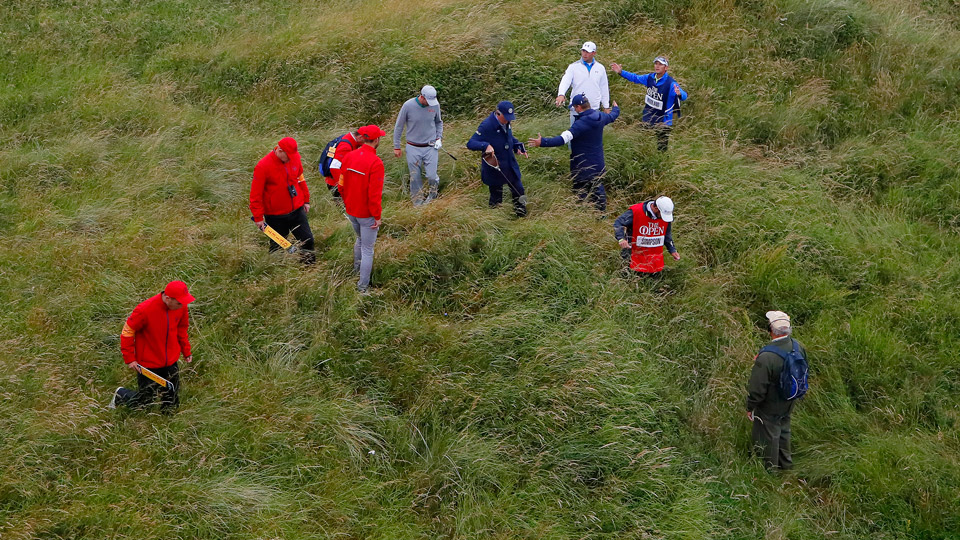 Webb Simpson gets some help in looking for his golf ball at the 2016 British Open at Royal Troon.