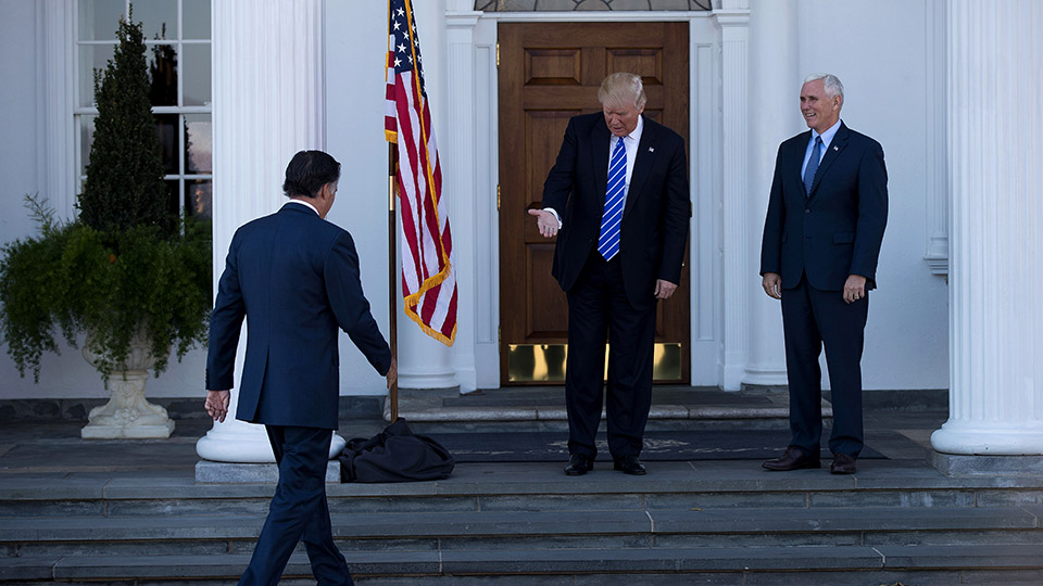 President-elect Donald Trump and vice president-elect Mike Pence welcome Mitt Romney to the clubhouse at Trump International Golf Club in Bedminster.
