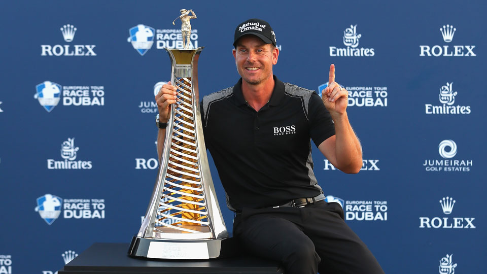 Henrik Stenson poses with the Race To Dubai trophy at the DP World Tour Championship.