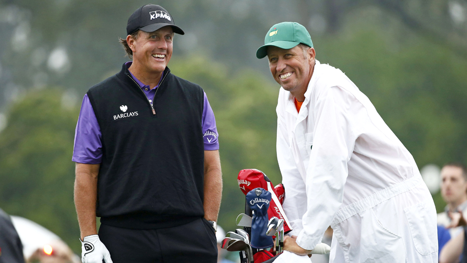"Phil Mickelson talks with long-time caddie Jim ""Bones"" Mackay at the 2015 Masters."