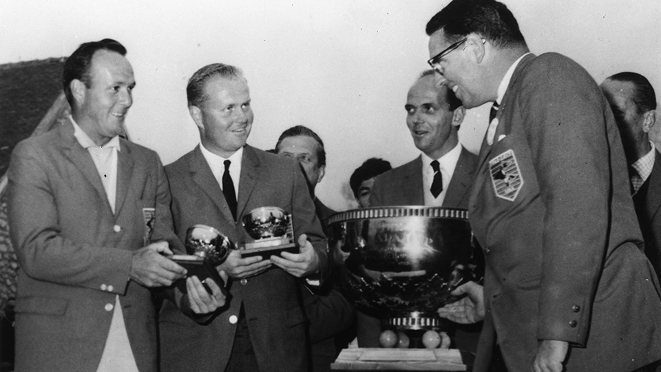 Arnold Palmer and Jack Nicklaus receive their prizes after winning the Canada Cup at Saint-Nom-La-Breteche, France.