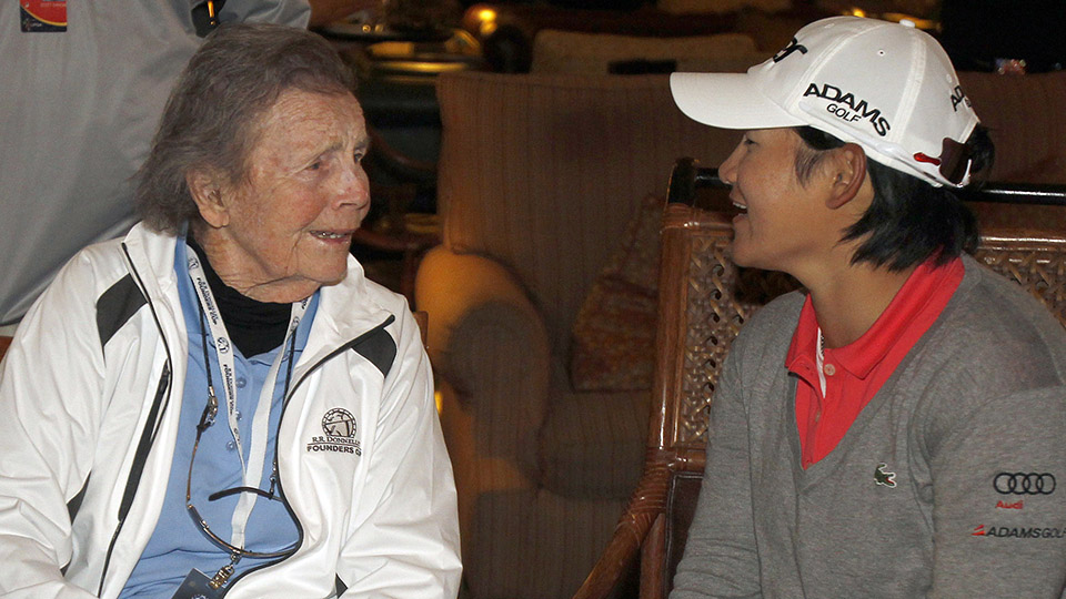 LPGA pioneer Peggy Kirk Bell chats with Yani Tseng following Tseng's victory at the 2012 Founders Cup.