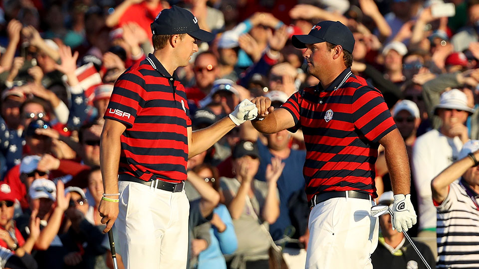 Jordan Spieth and Patrick Reed of the United States react on the 16th green during afternoon fourball matches of the 2016 Ryder Cup at Hazeltine National Golf Club.